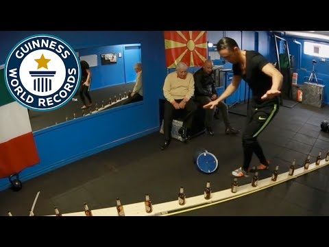 Fastest time to walk 10 m on glass bottles - Guinness World Records