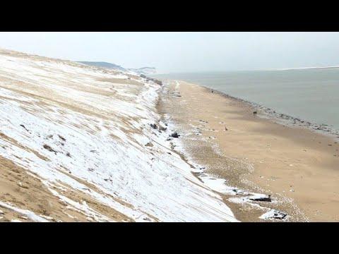 Snow falls on Europe's highest sand dune