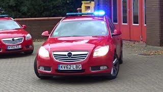 Fire Officer rushes to car for call - Fire car responding with sirens + lights