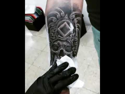 Realistic aztec skull tattoo in progress