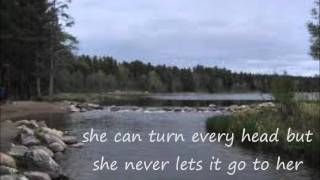 Tim McGraw- She Never Lets it Go to Her Heart lyrics