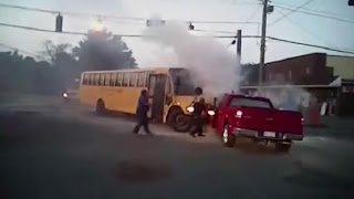 Amazing Bodycam Video Shows 7 People Rescue Driver From Burning School Bus
