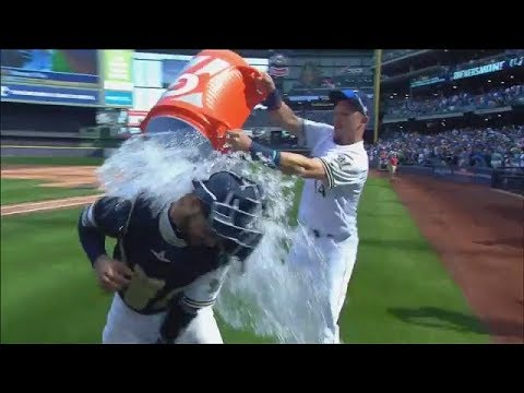 Brewers' Manny Pina gets a bucket of water from Hernan Perez