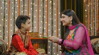 Young Indians happily performing Raksha Bandhan / Bhai Dooj traditions