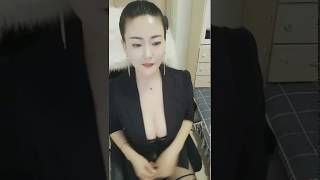 A Chinese girl with perfect breasts. She is beautiful and sexy, a woman of noble temperament.