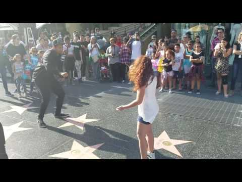 9year old girl stops and dances w street performer
