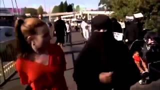 Muslims are not suppossed to get mad, Bu tthis one is raging out on a nice woman in red! .