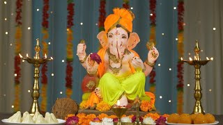 Decorated Lord Ganesha Idol kept for Ganesh Chaturthi puja - Colorful festive background