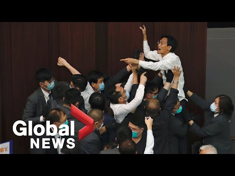 Pro-China and Democratic lawmaker scuffle in Hong Kong legislature over control of House