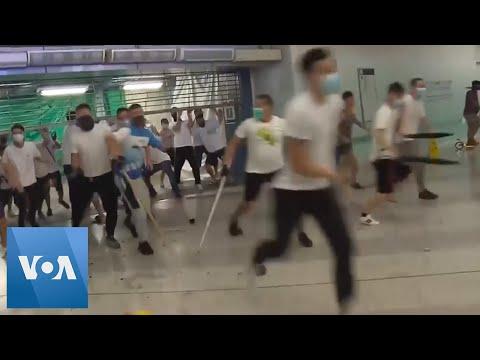 Attackers beat people on Hong Kong subway