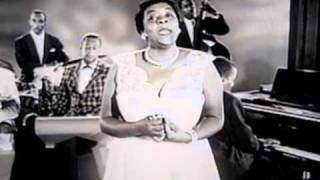Dinah Washington sings Only A Moment Ago