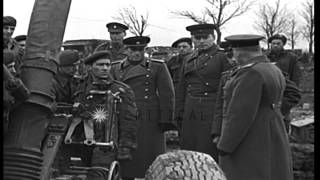 Soviet Officers visit British artillery unit, where they are shown British guns a...HD Stock Footage