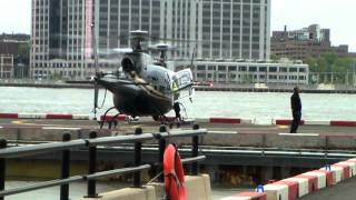 Helicopters coming and going at a busy port in NYC