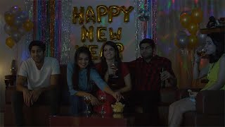 Young male and female friends celebrating New Year while watching TV at home