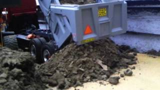 my dad's r/c dump truck dumping a load of dirt