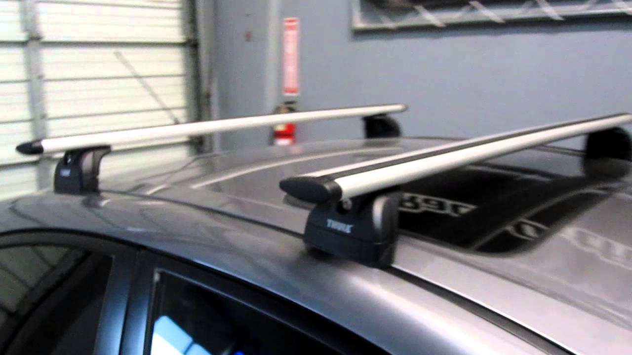 2008 Mazda 3 Sedan with Thule 460R Podium AeroBlade Roof