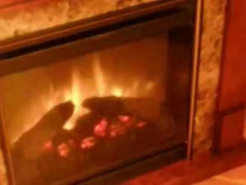 Dimplex rome с черным очагом gannon. Габариты (шxвxг): 1115х1000х381 мм. Характеристики: каминокомплект свободной установки с эффектром пламени optiflame портал (мдф/натуральный шпон) со встроенным очагом optiflame 20' скрытый тепловентилятор на 1 квт. Эффект пламени работает.