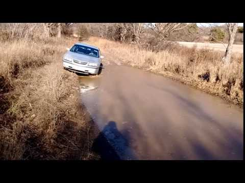 really awful video of a chevy impala sort driving through mud at the newtonville pits