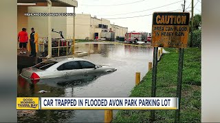 CAUTION: Area can flood in heavy rain; staying safe on flooded roads