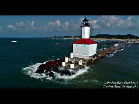 Waves Crash Over Lake Michigan Pier And Lighthouse 4K.