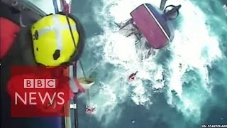 Helicopter rescue of fishermen from a sinking boat