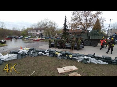 Quebec: Armed forces patrolling on boats and armoured vehicles during flood 5-11-2017