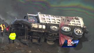 Uncut: Dump truck crashes into water off Interstate 93