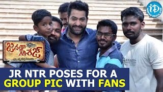 jr ntr poses for a group pic with fans on janatha garage sets