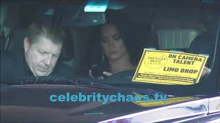 Demi Lovato plays on her cell phone while driving to American Music Awards 2017
