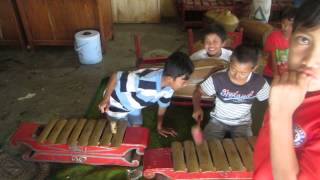 Children playing traditional music in Indonesia