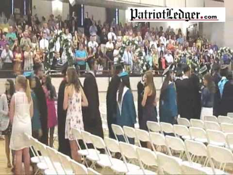 Some 236 proud graduates of Plymouth South High School in the processional into Memorial Hall in Ply