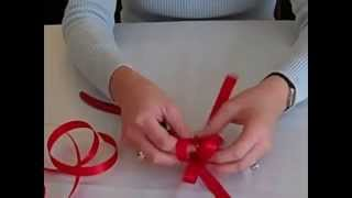 "Learn how to make a bow using ribbon. I show you ""from scratch"" how..."