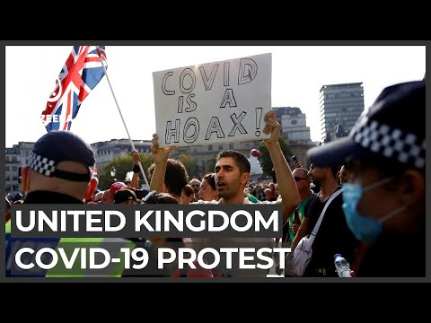 UK police and protesters clash during COVID-19 protest