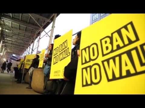 """Amnesty USA Projects """"No Ban No Wall"""" on DHS building"""