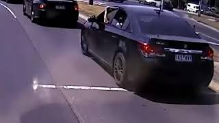 Car driver swerving onto the wrong side of the road and driving through oncoming traffic Free Download Mp3
