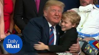 Young boy tries multiple times to give Trump a hug