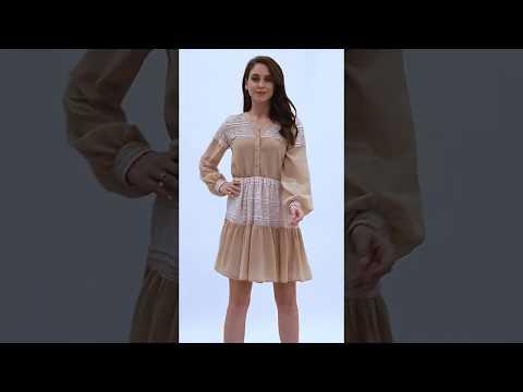Video: Kobieca sukienka mini z koronką i guzikami