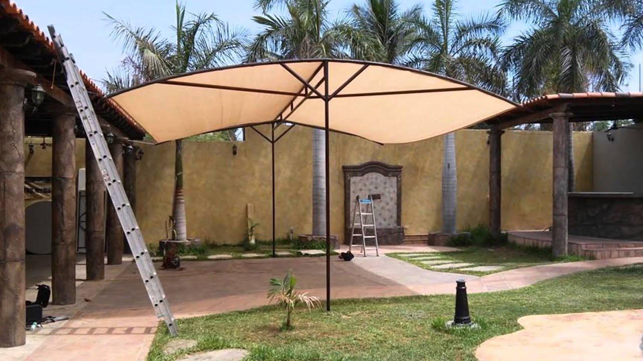 Malla sombras y estructuras mena youtube for Estructuras de jardin