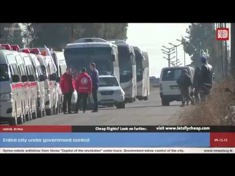 Syrian rebels and civilians leave Homs in truce deal