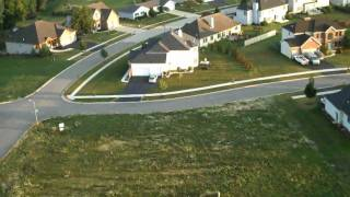 Flip Mino HD mounted to an RC plane (Slow Stick) at sunrise over my neighborhood.