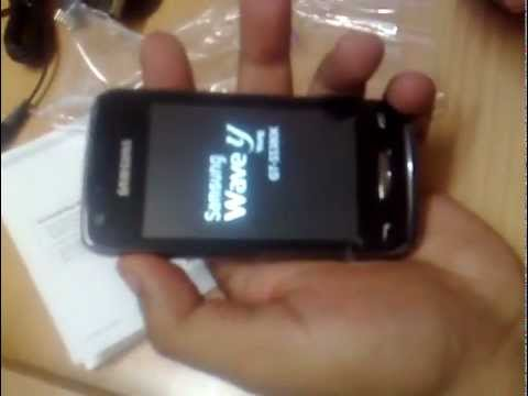 Samsung wave y unboxing. Inserting battery, memory card and SIM
