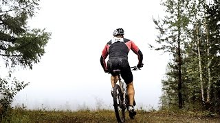 athlete mountainbiker rides bicycle on mountain trail