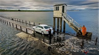 DRONE FILMS UBER TAXI PARTING THE SEA AND GETS STUCK ON HOLY ISLAND CAUSEWAY