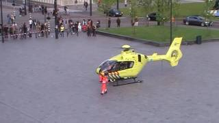 Emergency helicopter lands on busy train station square Rotterdam