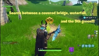 Fortnite - Search between a covered bridge, waterfall, and the 9th green!!!