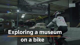 Trial biker explores museum on two wheels