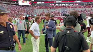Behind the scenes as Nick Saban does on-field CBS, ESPN interviews