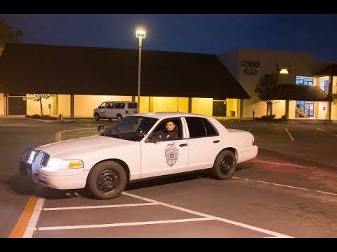 Calvary Chapel Costa Mesa Security Guard uses spotlight on photographer on public sidewalk