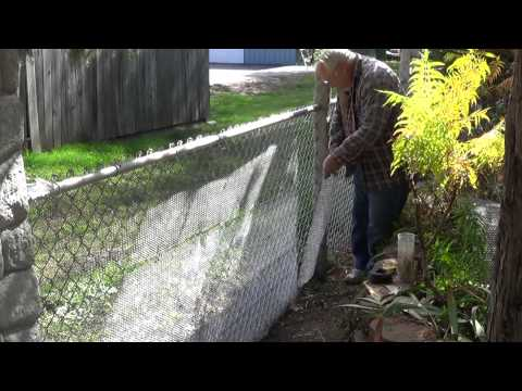 Converting my chain link fence to a stone wall