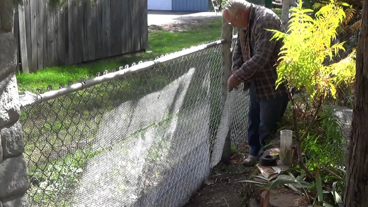 Converting my chain link fence to a stone wall youtube baanklon Images